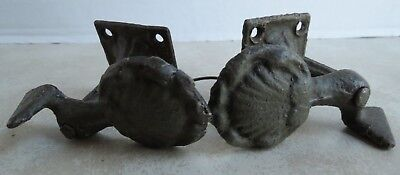 Vintage 2 piece set of Cast Iron Shell Design Shutter Dogs