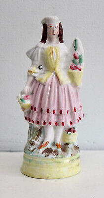 A Good c19th Antique Staffordshire Figure, Girl with Flowers