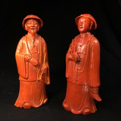Pair of Chinese figures in coral red glaze, Qing Dynasty 19th century