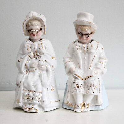 A Fun Pair of Antique c19th Porcelain Seated Seniors with Nodding Heads & Specs