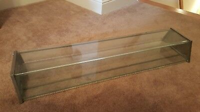 Antique long glass and nickel display case to display pieces of pies