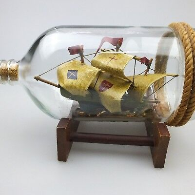 Vintage Ship in a Bottle on Wooden Stand