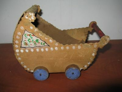 Antique wooden doll carriage of the 20s, folk....there is only one in the world