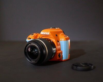 PENTAX K-50 Orange and Baby Blue with 18-55mm WR lens