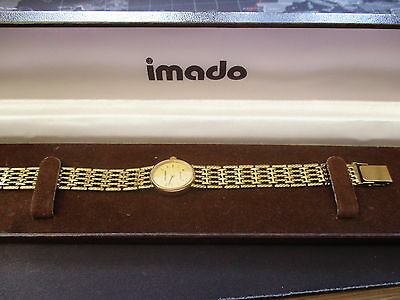 vintage ladies boxed   IMADO  quartz watch,running and decent condition