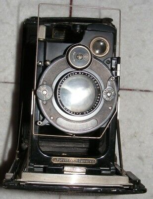 KW folding 6.5 x 9 plate camera, has Zeiss lens, Compur shutter. Made in Germany