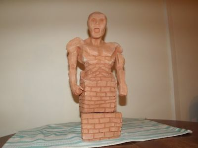 clay statue the bricking man
