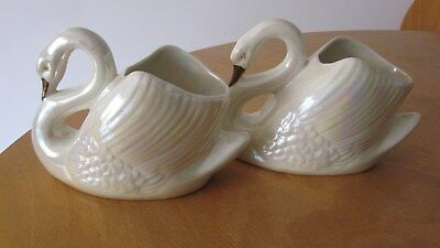 Wembley Ware pair of large white lustre glazed swans.Mark to bases.19cmx14cmhigh
