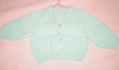 Handmade Knitted Baby Jacket in Patons 4ply baby yarn J406