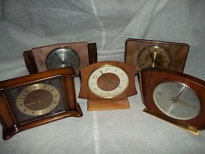 job lot (5) battery operated mantle clocks require T L C