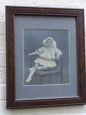 ANTIQUE VICTORIAN PHOTOGRAPH SMALL GIRL SITTING  IN CHAIR OAK FRAME 1900's