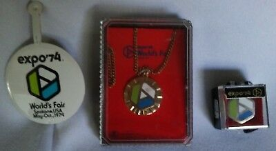 Lot of 3 Expo 74 Collectors items. Pin, necklace & tin pin. All unused