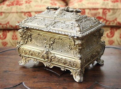 A Magnificent, Large & Heavy Gilded Cherubic Casket with Lock and Key