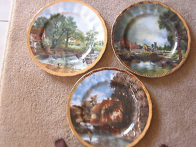 THREE COLLECTABLE PLATES  CONSTABLE  PAINTINGS WITH 22ct GOLD BORDER; 27CM DIAME