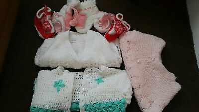 Baby girl bundle knitted cardigans and   booties. Hand made