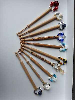 10 Lace making wooden bobbins with spangles Loughborough inscription on one  W