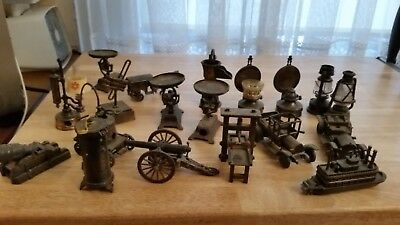 a mixed lot of antique cast iron pencil sharpeners