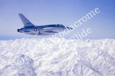 F-105 air-to-air in-flight over snow-capped mountains - Kodachrome 35mm slide