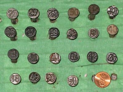 22 different smaller head and shank 3/16 inch Steel Railroad date nails