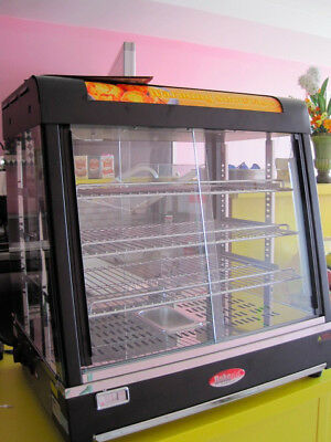 The BakeMax Countertop Showcase BMCSC01 operates as a dry or heated case