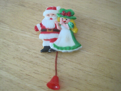 Christmas Pin With Pull String To Move Arms & Leg. Plastic. Santa & Girl.
