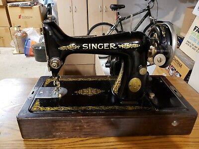 antique sewing machine singer built in wood case has manual