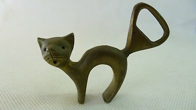 Wonderful old solid brass highly detailed surprised looking Cat Bottle Opener