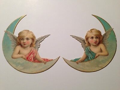 A Scarce Pair Of Angels On A Quarter Moon