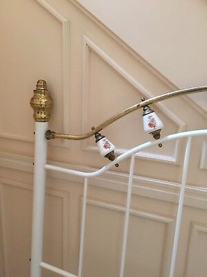 double brass bed, porcelain knobs. Needs a bit of tlc on brass otherwise good