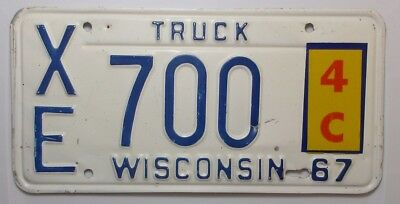 1967 Wisconsin Embossed Truck License Plate  #  XE 700