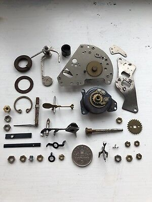 Vintage Various Clock Parts Including Hands,cogs. Hermle clock movement, etc