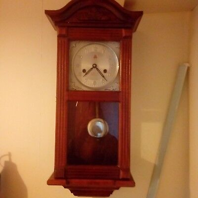 Vintage chiming wall clock in beautiful wooden case. Fully working with key