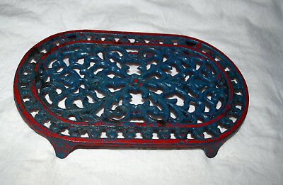 "CAST IRON TRIVET Stand Hot Plate Oval Open Scroll Red & Green 9 x 5"" w Legs"