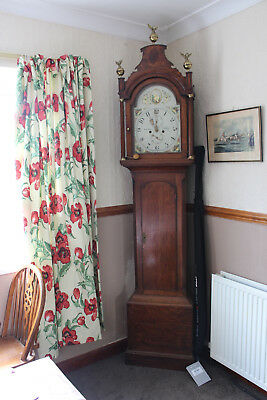 Antique painted face long case clock in very good condtion