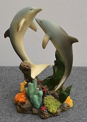 """Dolphins swimming over coral figurine resin 8"""" high"""