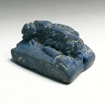 Early Islamic black  tube bead with white strips