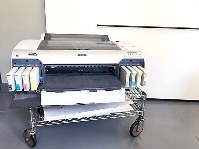 Epson Stylus Pro 4880 printer with extra roll paper and inks