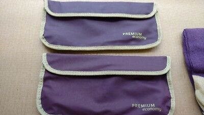 set of 2 Virgin Atlantic travel bags with some amenities -purple with red lining