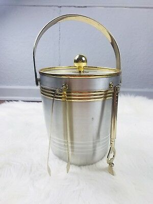 Silver and gold mid century modern ice bucket with serving utensils barware bar