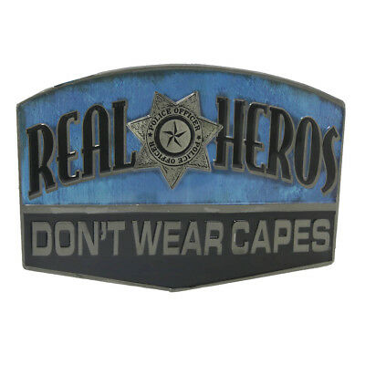 """Vintage Police Officer Sign """"REAL HEROES DON'T WEAR CAPES"""" Embossed Metal Tin"""