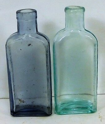 LOT of 2 DIFFERENT COLOR c1900 BOTTLES -   ICE BLUE & AGUA - THREE IN ONE  OIL