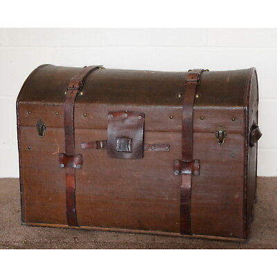 An Antique Leather Bound & Canvas Dome Topped Travel Trunk