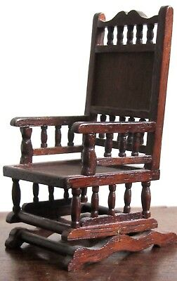 """Detailed, miniature rocking chair with cushion. c.1920s. 4"""" high."""