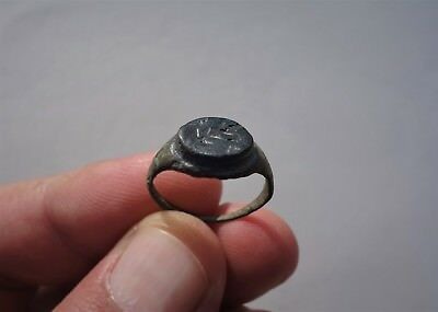 ancient Roman bronze ring with blue glass intaglio,displayed a branch