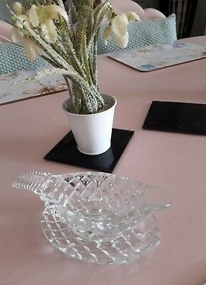 Minature crystal cut glass sauce boat and seperate stand.