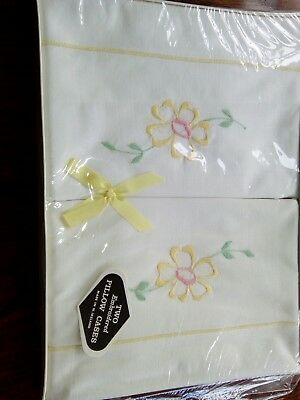 Pair of vintage pillowcases yellow  embroidery unused in box Irish