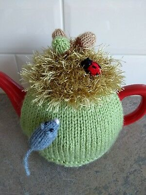 Hand-knitted Autumn tea cosy with mouse, acorns and ladybird