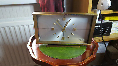 vintage brass seth thomas mantel clock,made in scotland.silver face gold hands.
