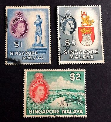 3 nice old used stamps Singapore Malaya Queen Elizabeth II.