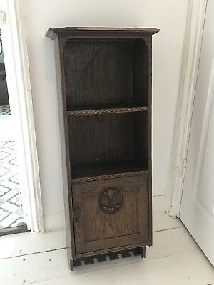 Antique Arts and Crafts wall shelf/cupboard, decorative carved roundel and inlay